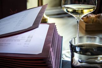 menus and a glass of wine